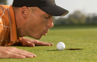 Man putting a golf ball