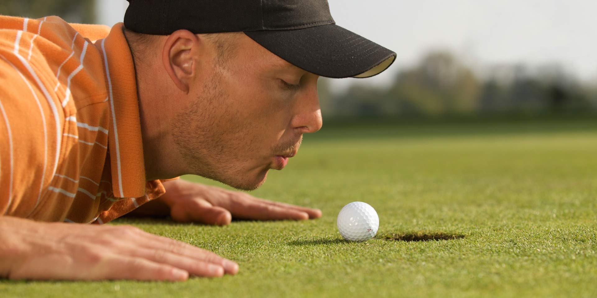 Man putting a golf ball