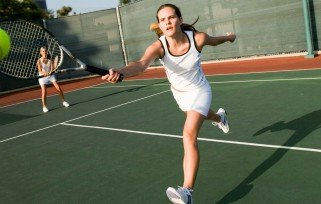 Woman playing tennis in Ocala.