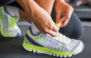 lacing up running shoes