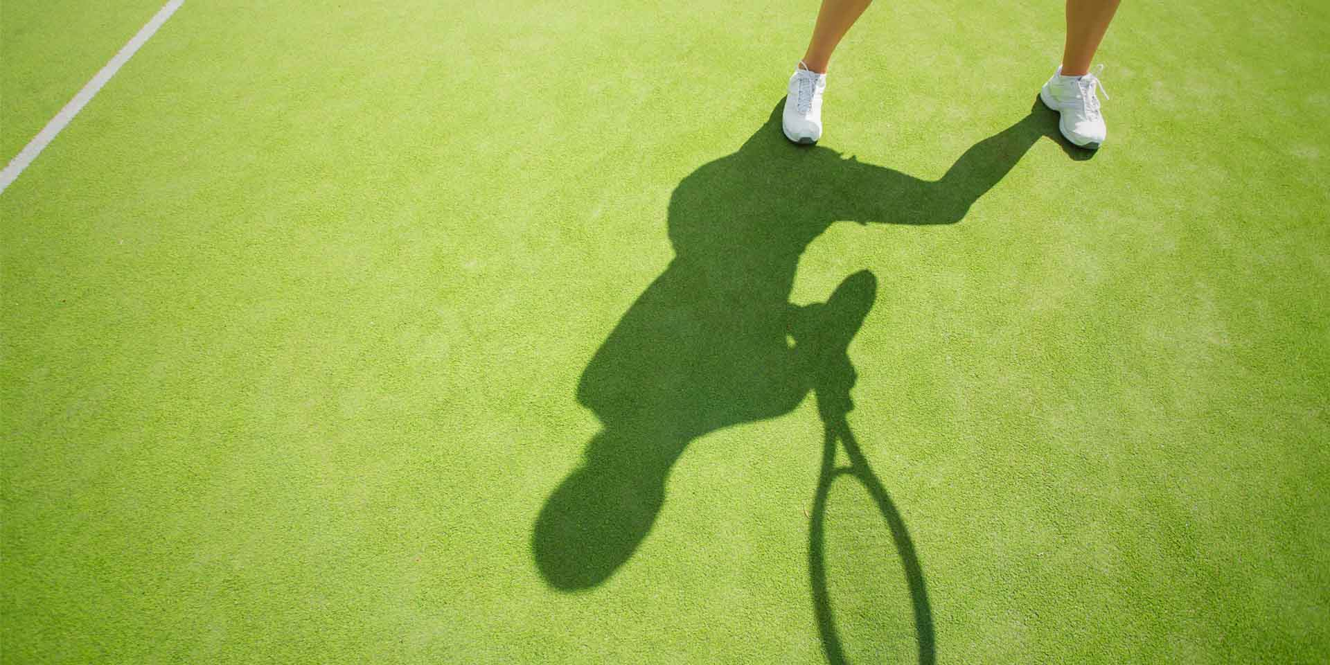 Tennis player's shadow.