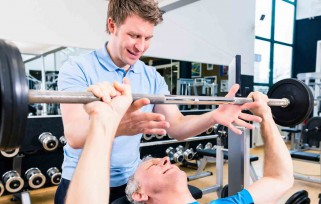man working out with trainer