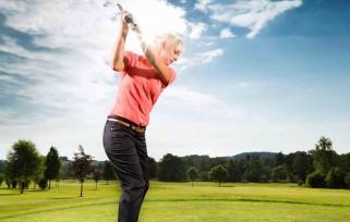 golf player swinging a club