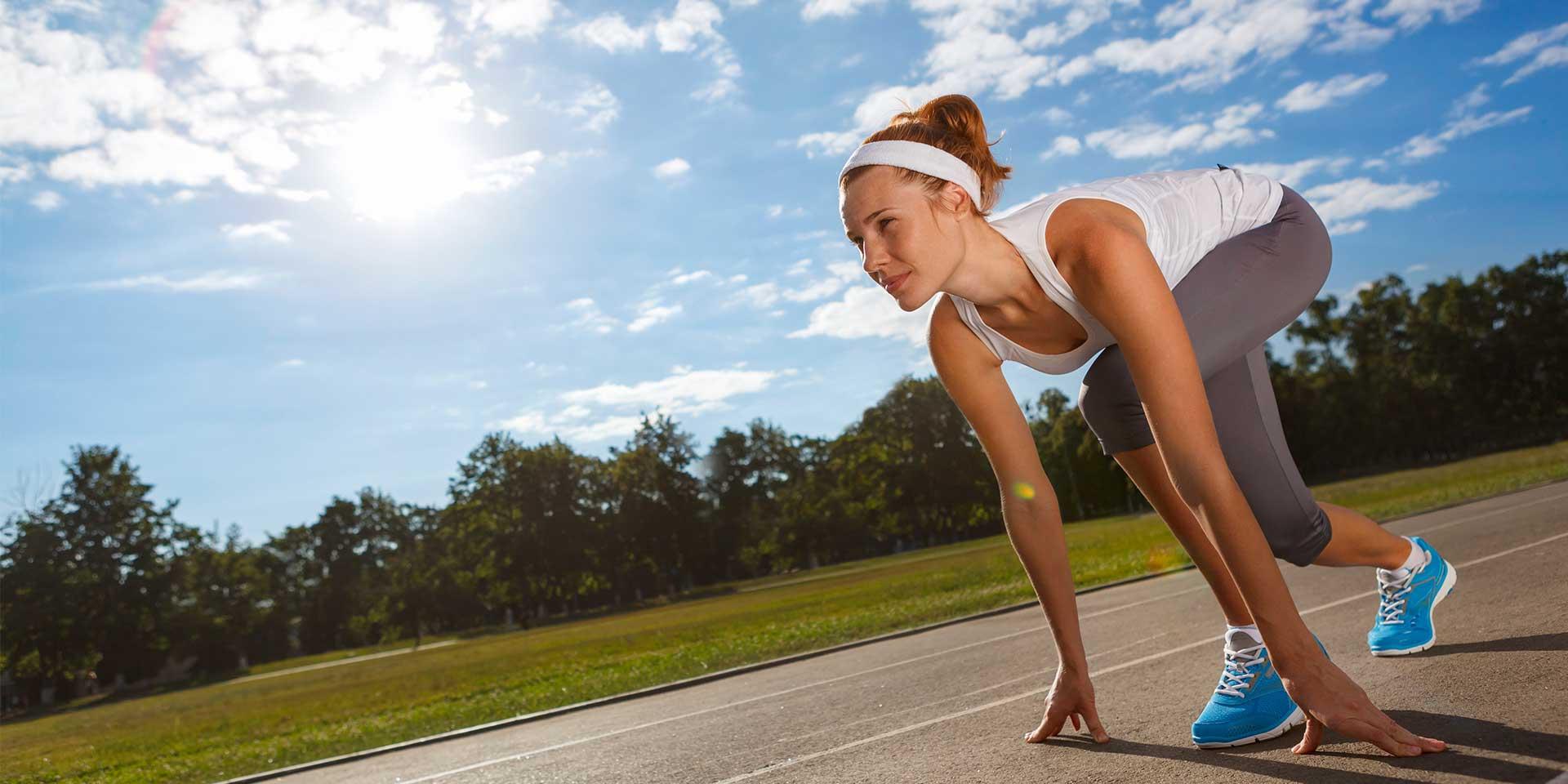 Woman prepping to run.