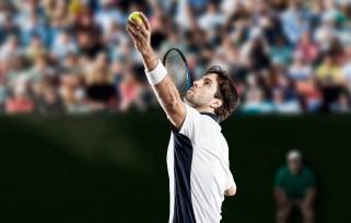 Man serving tennis ball.